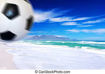 2010 World Cup - Soccer ball kicked on the beach with table...