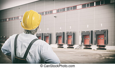 worker with protective uniform in front of shipping...