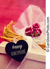 heart-shaped signboard with the text happy honeymoon -...