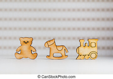 Wooden icon of Teddy bear, childrens rocking horse and...
