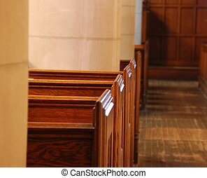 Reflection of light on church pews - a light reflects on...