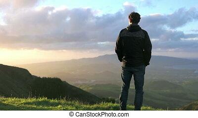 Watching birds fly - Young caucasian man watching birds in...
