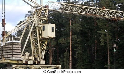 rail crane - old russian rail crane is working at a small...