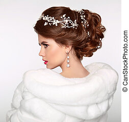 Wedding Hairstyle. Attractive girl in white fur coat....