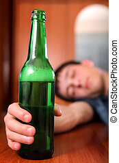 Young Man with the Beer - Tired Young Man sleep with the...
