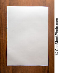 white sheet of paper on wooden background