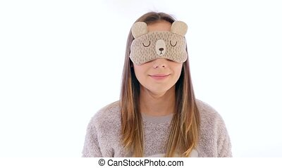 Young Woman Taking off Sleep Mask and Streching - Young...