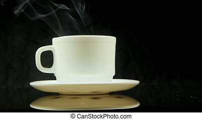 A cup of hot coffee with steam