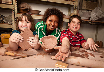 Teacher and students in clay studio - Teacher and young...