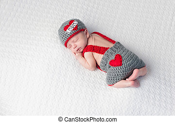 Baby Boy Wearing a Love Mom Hat - Four week old sleeping...