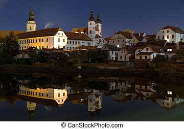 Night view of Telc or Teltsch town mirroring in pond, Czech...