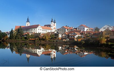 Morning view of Telc or Teltsch town mirroring in lake,...