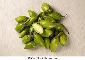 Some green african eggplants over a white background. Fresh...