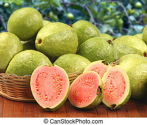 Some brazilian guavas over a striped surface. - Some...