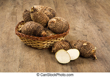 Taro or yam over a wooden background.