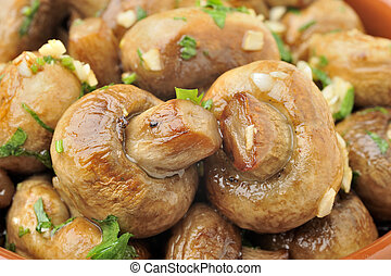 Casserole sauteed mushrooms with garlic and parsley on white...
