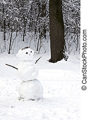Snowman winter in the forest