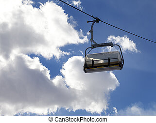 Chair-lift and sunlight sky at evening