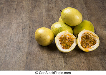 Close up of some passion fruits over a wooden surface seen...