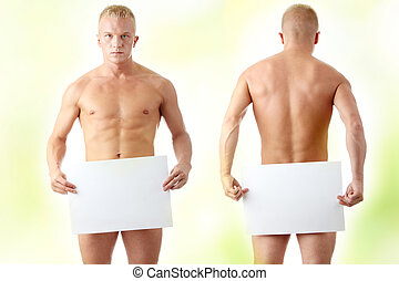 Young muscular nude man covering a copy space blank...