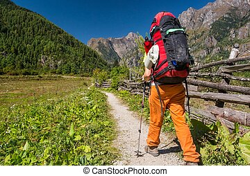 Female hiker walking on a path.