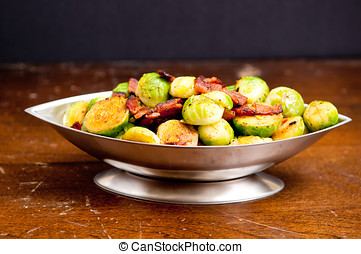 fried brussel sprouts with chopped bacon - side dish of...