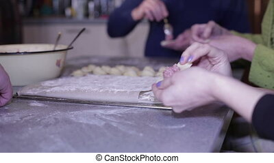 Women's hands are preparing meat dumplings - Woman fork...