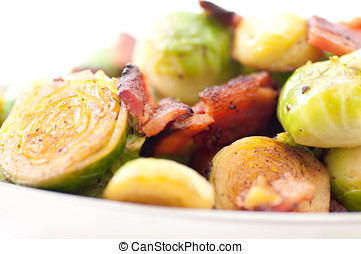 fried brussels sprouts with chopped bacon - side dish of...