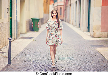 lady walking down the ancient street - Young and beautiful...