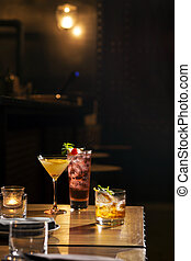 Three glass of cocktail serve on bar table