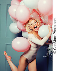 young happy blonde real woman with baloons smiling close up...