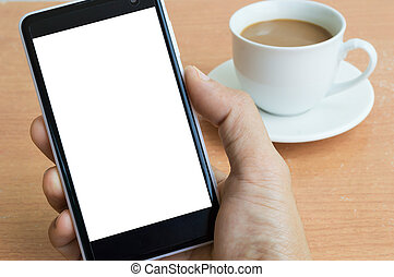 Hand holding a phone with the background of coffee cup on the table