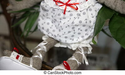 Doll with flowers on the table - Doll with flowers on a...