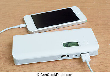 smartphone with a power bank on desk