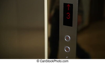 Press the elevator button - Elevator button lights up red in...