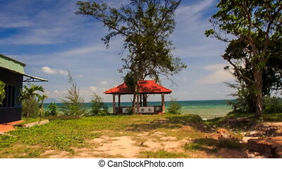 Camera Approaches Red Roof Pavilion and Azure Sea Beach -...
