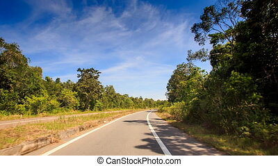Camera Moves along Line on Highway between Barriers - camera...