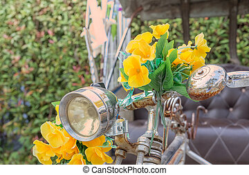 old handle bar of bicycle with artificial flower, vintage