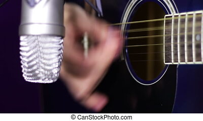 Recording Acoustic Guitar in the Studio - Man playing guitar...
