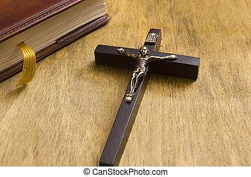 Catholic wooden crucifix and book - Catholic wooden crucifix...
