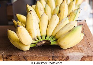 Bananas fruit put on wooden board.