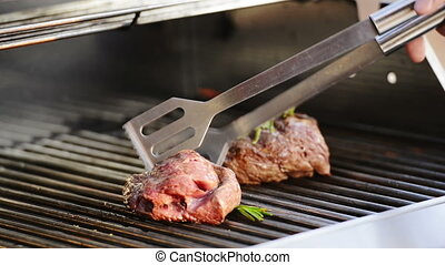 Sealing Steak on BBQ - Grilling beef fillet steak on the...