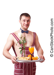 Attractive man in an apron with breakfast on a tray