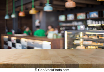 Selected focus empty brown wooden table and Coffee shop blur...