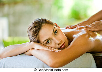 Woman At Spa - An attractive young woman enjoying a back...