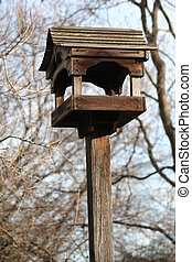 Bird House - Close up of a bird house in a park.
