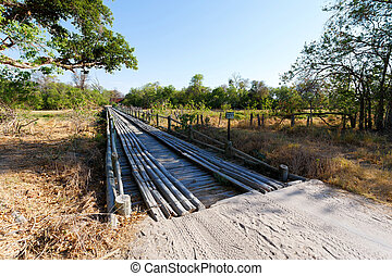 wooden bridge over Okavango swamps, Kwai region, Okavango...