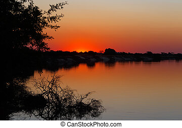 African sunset on Zambezi river, Caprivi strip region,...