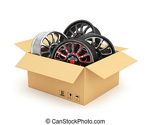 Open cardboard box with car rims on white background. Auto...
