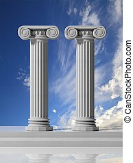 Two ancient pillars with blue sky background.